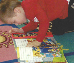 Picture of a preschool child reading a book